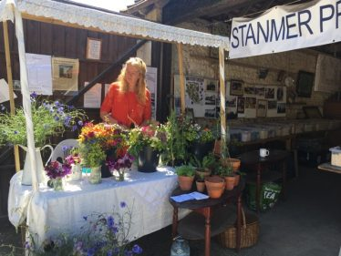 Recreation of the flower stall in Charlie Yeates' painting